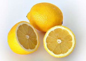 This image shows a whole and a cut lemon. It i...